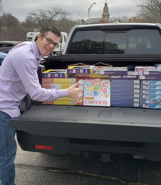 Y Staff Delivers Toys And Games To Families In Need